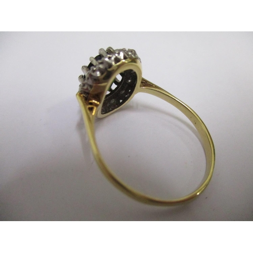 11 - An 18ct gold, diamond and oval cut green tourmaline dress ring, total weight 4.20g...
