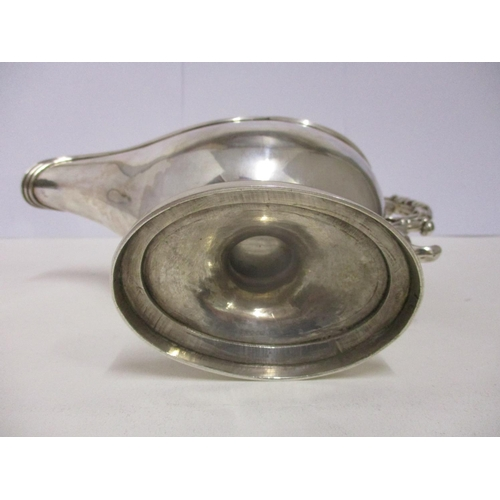 16 - A 20th century  French silver gravy boat, height including handle 7