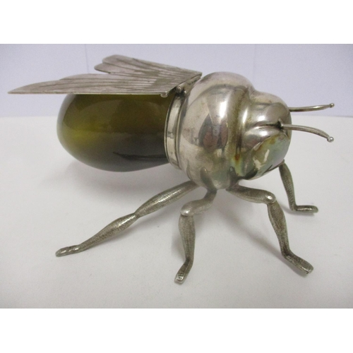 17 - A Mappin & Webb silver plated preserve pot, fashioned as a bee with hinged wings and a green glass b...