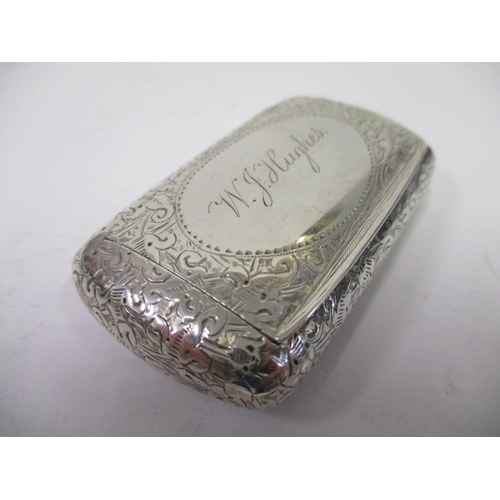 21 - A Victorian silver snuff box by FJH Thomas Birmingham 1894 of cushion form with all over engraving, ...