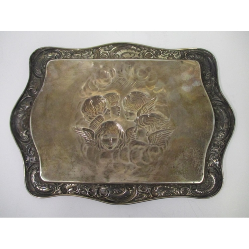 22 - A silver dressing table tray by Henry Mathews 1896, Birmingham in embossed and chased with a rococo ...