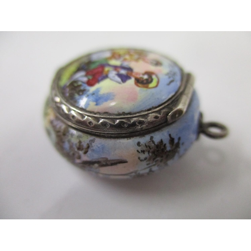 24 - An Austrian silver gilt and enamel vinaigrette of circular form decorated with a couple in a country...