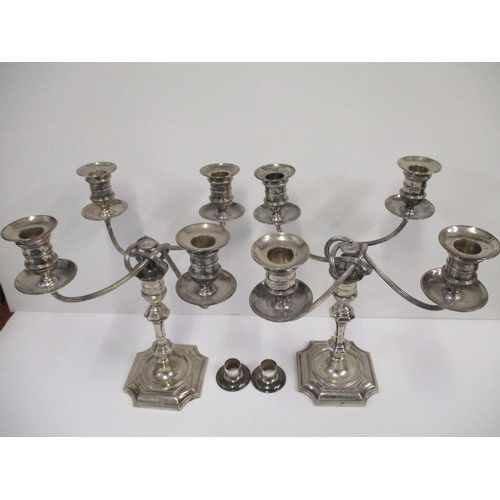 26 - A pair of Victorian silver four branch candelabra by Elkington & Co, Birmingham, the base hallmarked...