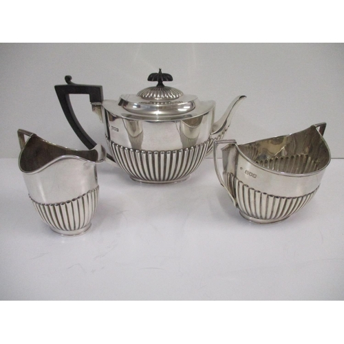 27 - A Victorian silver three piece tea service by William Hutton and sons London 1898, comprising a teap...