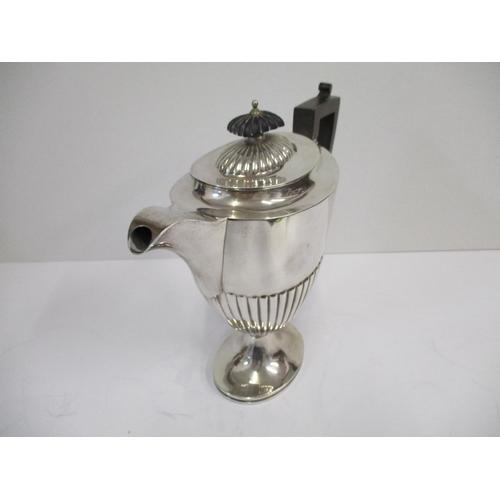 28 - An Edwardian silver hot water jug by Richard Martin and Ebenezer Hall Sheffield 1909, of ovoid form ...