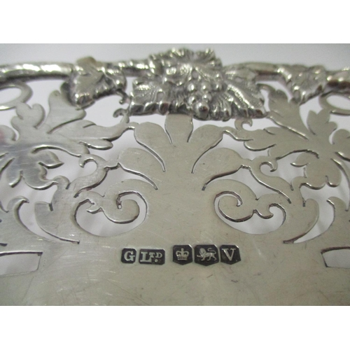 32 - A silver oval dish, by Gladwin Ltd Sheffield 1938  with cast grape and vine edge and a leaf, pierced...