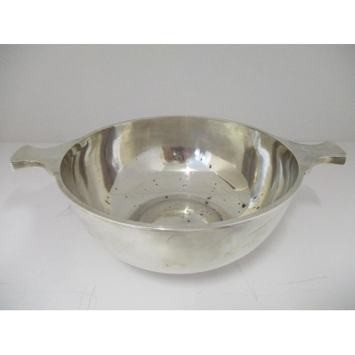 33 - A large silver porringer, by Mackay & Chisholm Edinburgh 1938 with twin waisted handles and a convex...