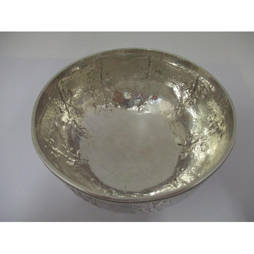 34 - An early 20th century silver bowl, by John Paul Cooper London 1923 , with a bead rim, embossed with ...