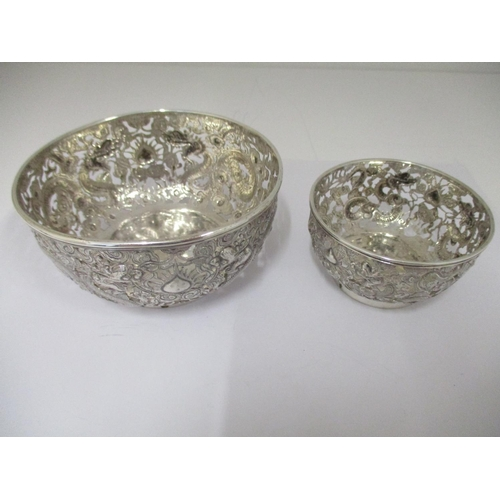 36 - Two late 19th/early 20th century Chinese silver bowls, by HM 1880/1910 , embossed and pierced with d...