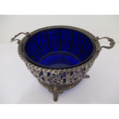 38 - An early 20th century silver bowl with a blue glass liner, Birmingham 1929 by Mappin & Webb, with tw...