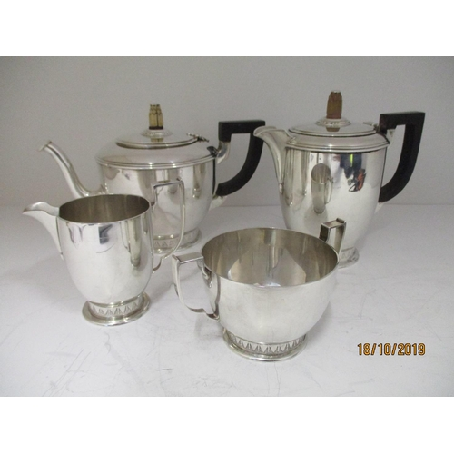 47 - A matching silver teas service, the teapot and hot water pot, London 1932, by WW, the milk jug and s...