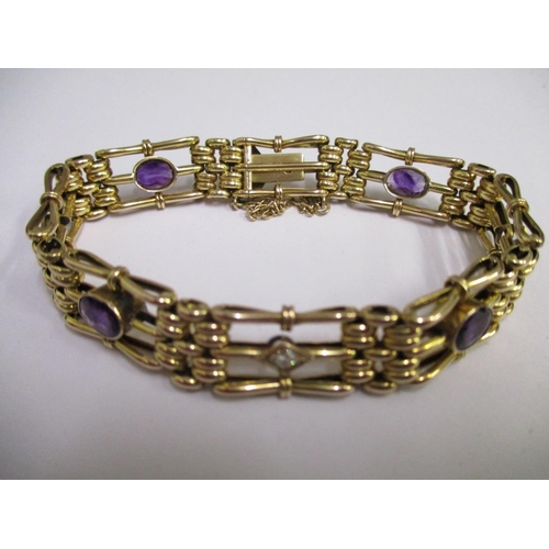 5 - A 9ct gold, diamond and amethyst gate link bracelet, total weight 16.80g...