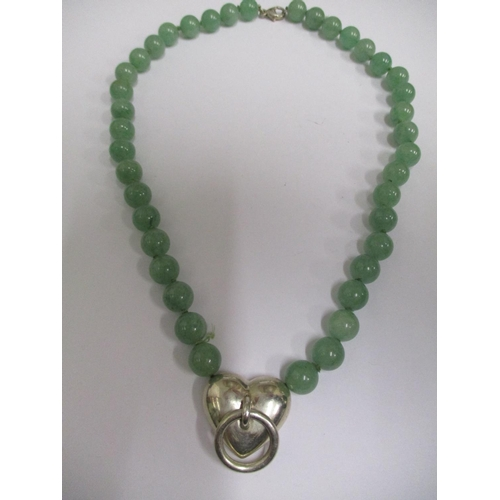 8 - A Tiffany & Co jade and silver necklace, with a hart and ring pendant 18