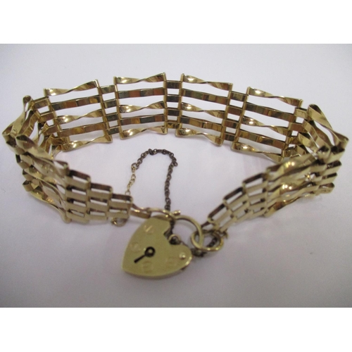 9 - A 9ct gold gate bracelet with a 9ct gold padlock, 10.25g...