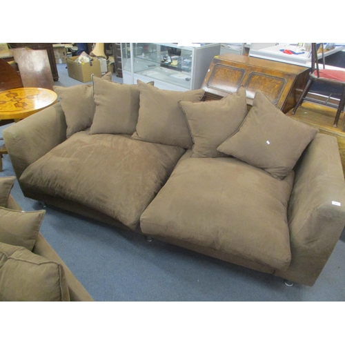 485 - A modern brown three-seater sofa with overstuffed cushions  Location C...
