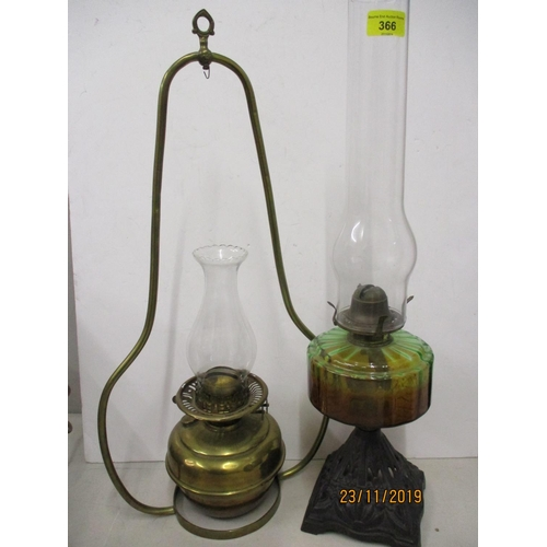 482 - A Victorian brass hanging oil lamp (shade deficient), together with a Victorian oil lamp to include ...