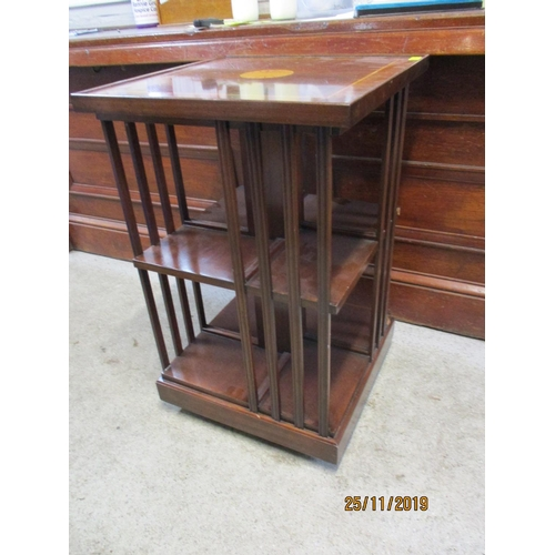 484 - A reproduction mahogany swivel bookcase, 31