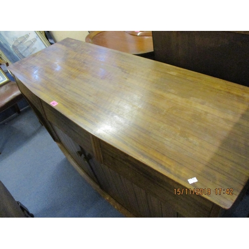 480 - A mid 20th century walnut sideboard with three drawers and two tambour doors Location ROS...