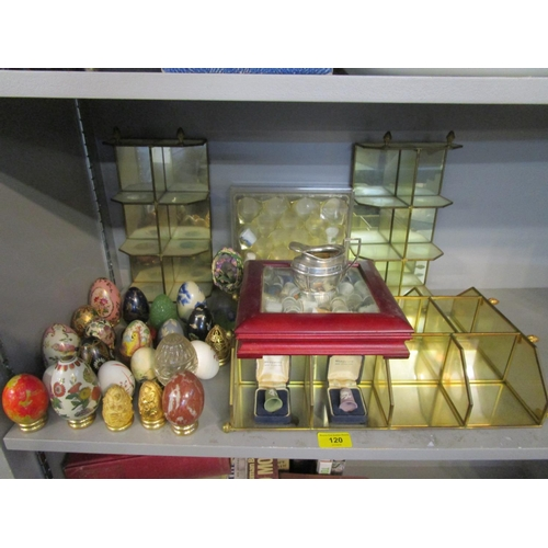 486 - A collection of ornamental eggs and thimbles to include two Wedgwood Jasperware boxed examples, gilt...