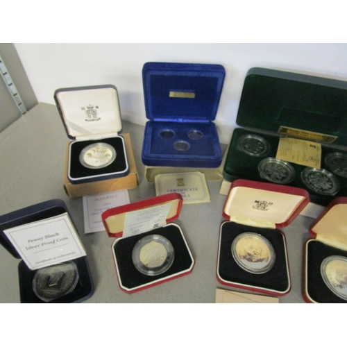 497 - A collection of Isle of Man, Guernsey and other Commonwealth commemorative silver proof coins and co...