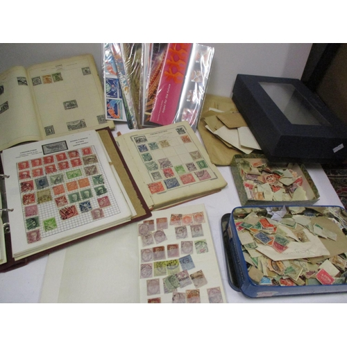 498 - Three stamp albums containing worldwide stamps including China and Czechoslovakia, a stock book to i...