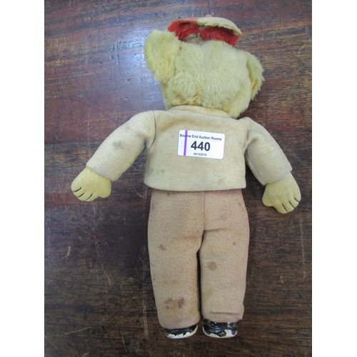 440 - A 1920s/30s schoolboy teddy bear, wood wool filled jointed head with glass eyes, cloth body with ori...