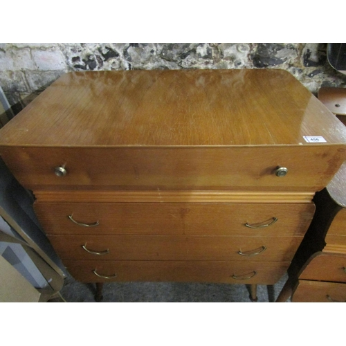 456 - A mid 20th century oak chest of four drawers and a matching three drawer dressing table Location G...