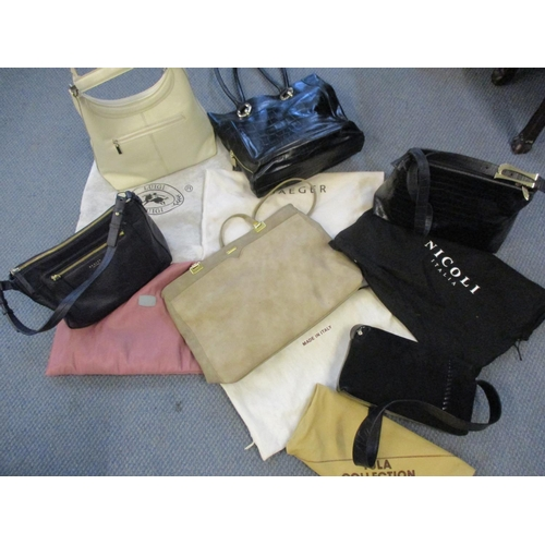 490 - Six modern leather handbags to include Radley, Luigi and Jaeger, together with matching dust-bags Lo...