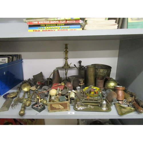 493 - A mixed lot of brassware and other items to include garden pumps, candlesticks Location G...