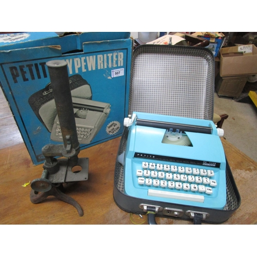 507 - A Playcraft Petite Typewriter and a gilt and black painted metal microscope Location G