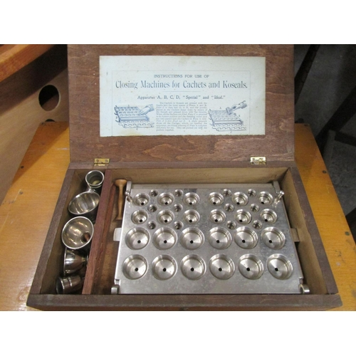 510 - Wooden cased closing machine for cachets and koseals Location G...