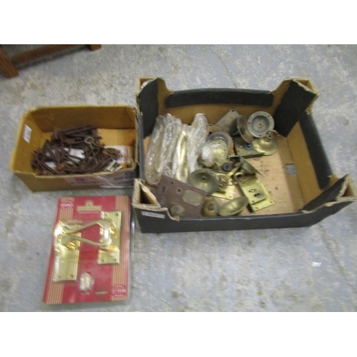 511 - A box of miscellaneous keys, brass locks and other door furniture Location G...