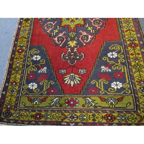 514 - Two Afghanistan rugs, red ground, triple guard borders, each 62