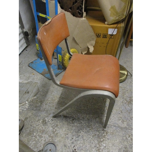 465 - A mid 20th century aluminium framed chair with a leatherette upholstered back and seat with an Esava...