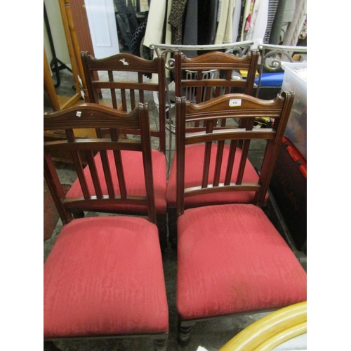 442 - A set of four Victorian walnut framed dining chairs with spindle backs and upholstered seats, on tur...