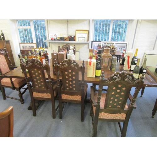 518 - A modern plank constructed oak refectory style table and six chairs to include two carvers and four ...