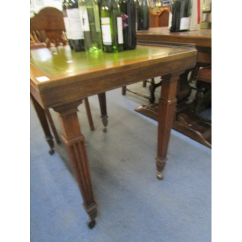 520 - An oak framed desk with leather scriber and gilt rail, fluted squared legs with later castors and an...
