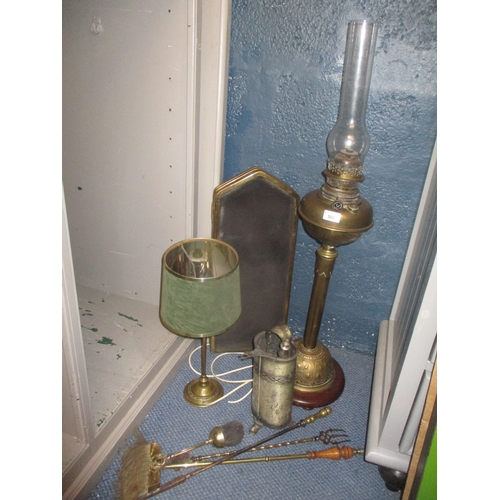 500 - An early 20th century Youngs Central Dought 30  court brass oil lamp, together with other brass item...