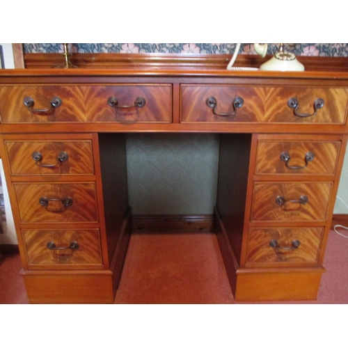 1 - A reproduction mahogany twin pedestal desk, two long drawers above short drawers, 31