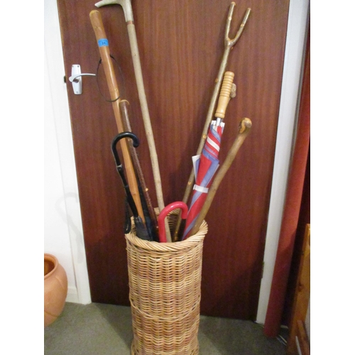 24 - A selection of miscellaneous walking canes and mixed sticks and a wicker basket Location: LWM...