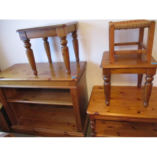 25 - A small quantity of miscellaneous pine furniture to include a tall bookcase with fluted columns stan...