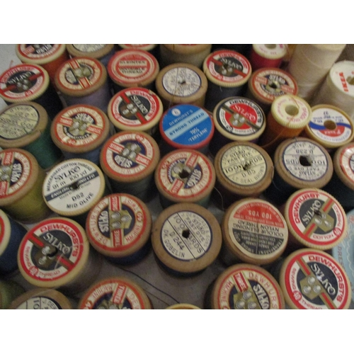 42 - A sewing basket and contents to include wooden cotton reels such as Silko and Barbours, together wit...