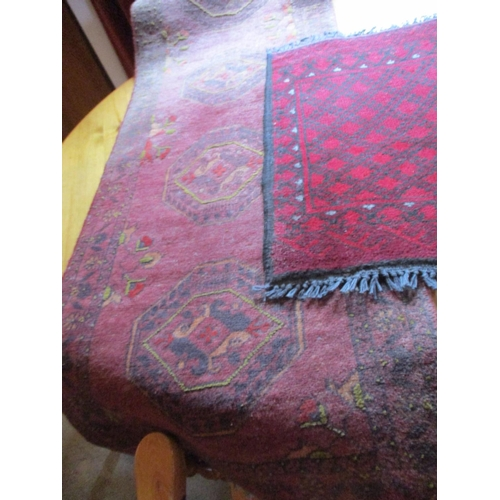49 - An Afghanistan red wool rug and companion Location: LAM...