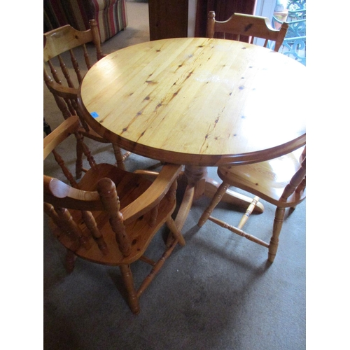50 - A late 20th century pine breakfast table, together with two matching carvers and two dining chairs L...
