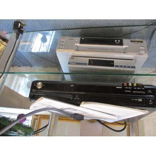 33 - A Panasonic Viera flatscreen television, VHS cassette player and a Sanyo combination unit with remot...