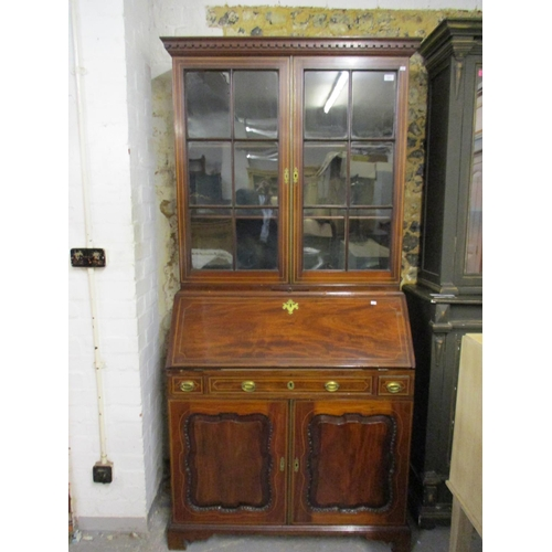 50 - A George III and later ebony and boxwood inlaid, mahogany bureau bookcase, with a dentil moulded cor...
