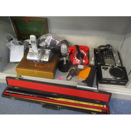 25 - A mixed lot to include a snooker cue, telephones and portable DVD player Location:8:5...