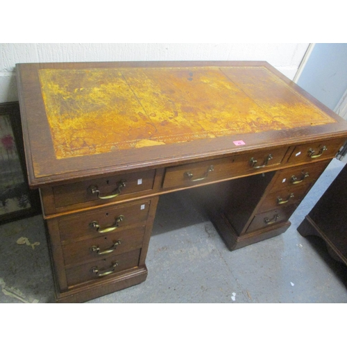 43 - Circa 1900 an oak twin pedestal desk, one central drawer flanked by four short drawers, each pedesta...