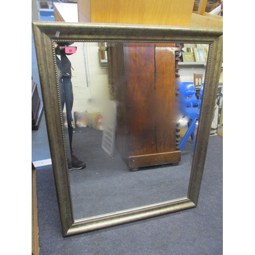 59 - A modern silver coloured wall mirror having a beaded rim and bevelled glass, 39 1/2