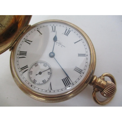 14 - An early 20th century Waltham 9ct full hunter, keyless wound pocket watch.  The white enamel dial ha...